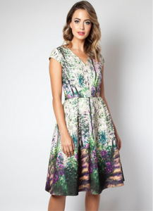Beautiful watercolor floral print dress that's perfect for spring. Purple, green, and cream print dress from Voodoo Vixen. Zippered back and cap sleeved.