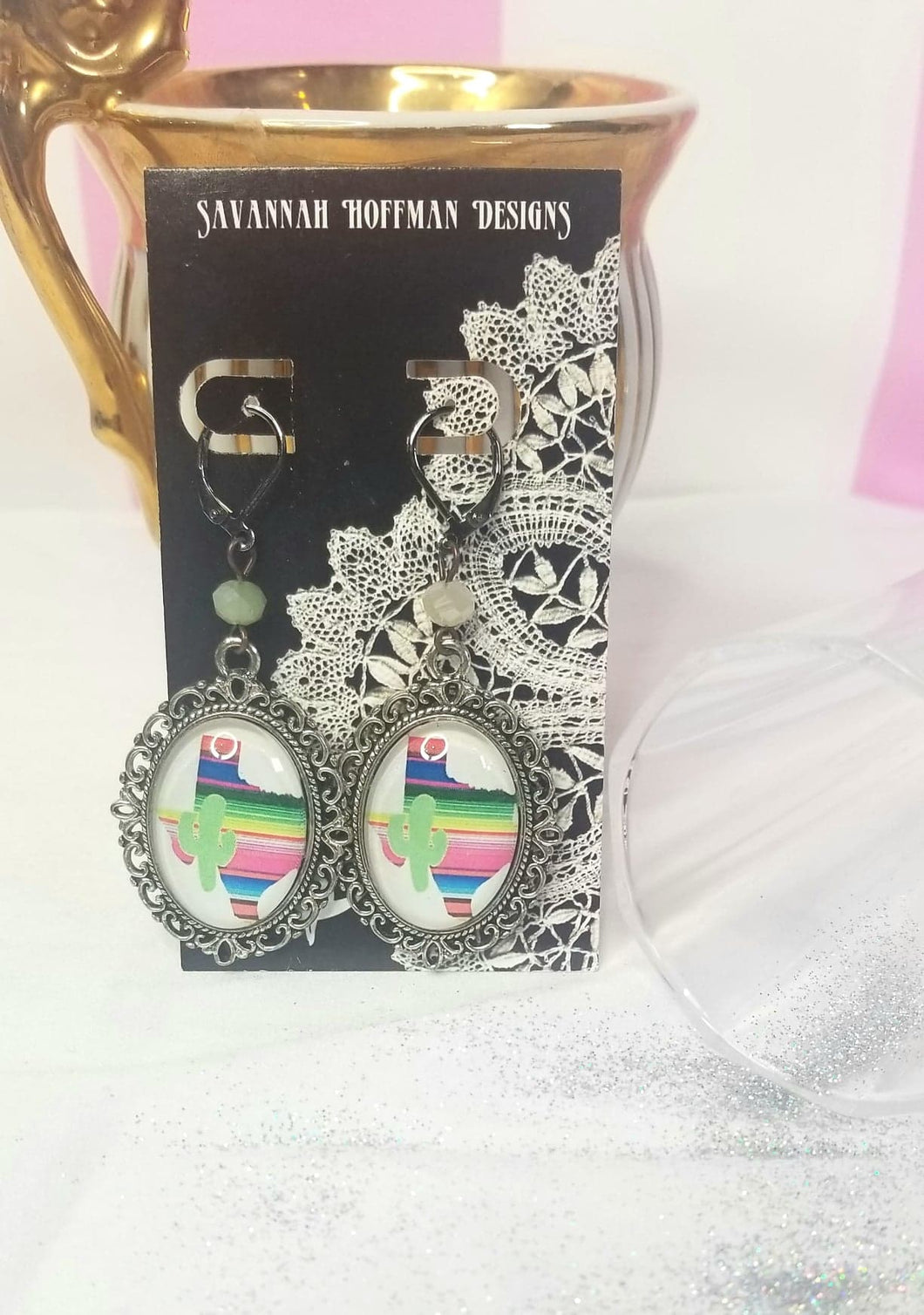 Pendant earrings with a rainbow Texas and cactus