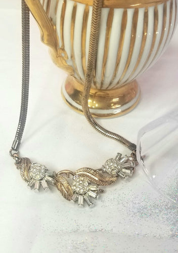 Vintage gold necklace of twisted vines and leaves, with inset silver bugle beads and rhinestones.