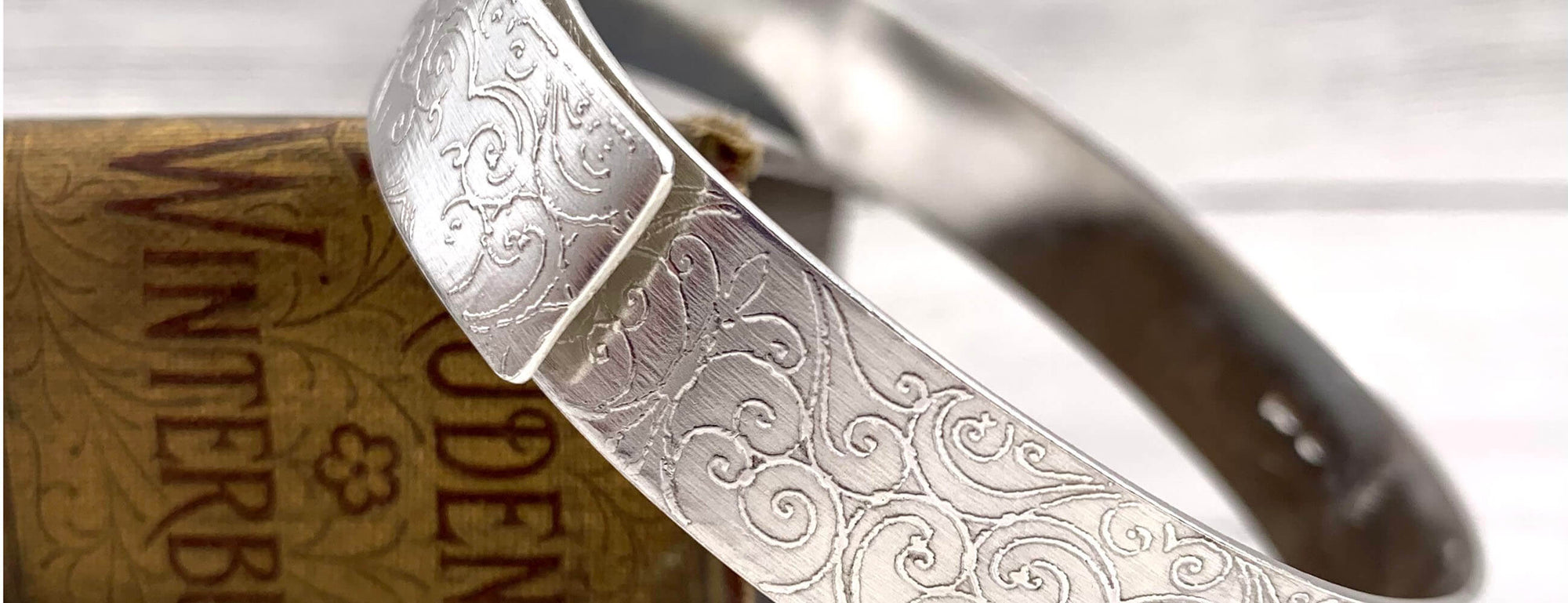Anna Roebuck Etched Aluminium Cuffs, unique British gifts brought to you by Ferrers Gallery