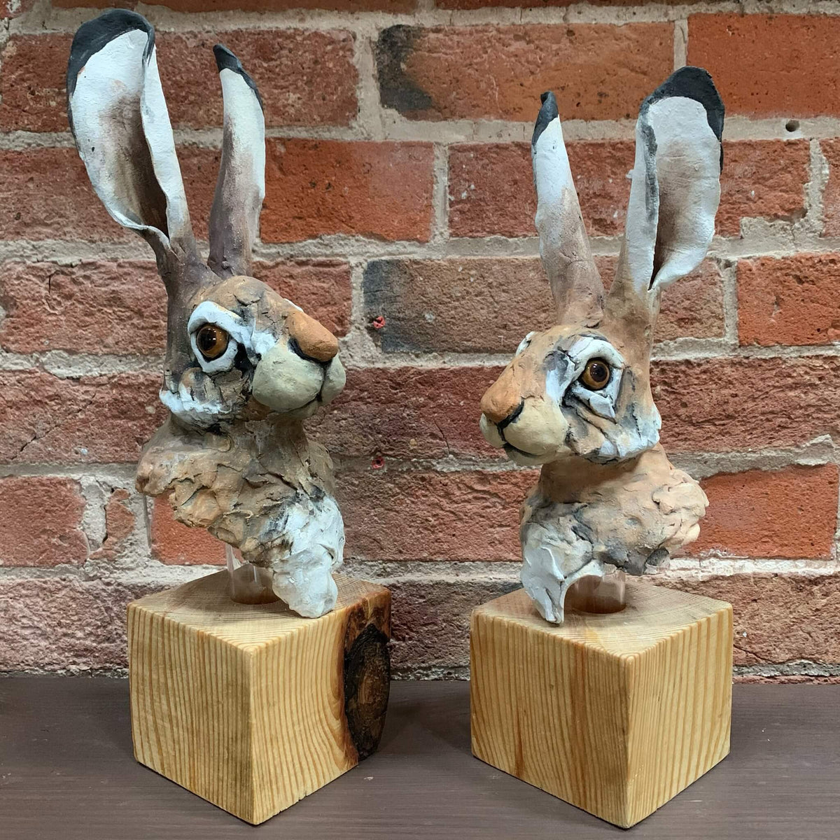 Ceramic Sculpture - Hare Head on Wooden Block by Louise Brown