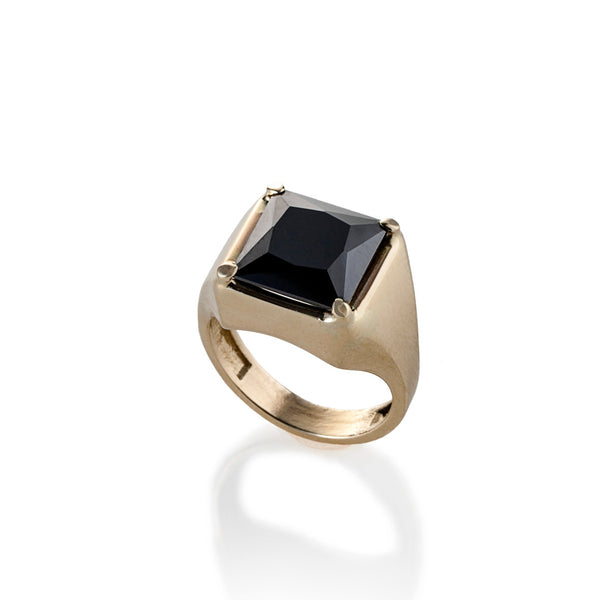 14k gold ring with a black stone