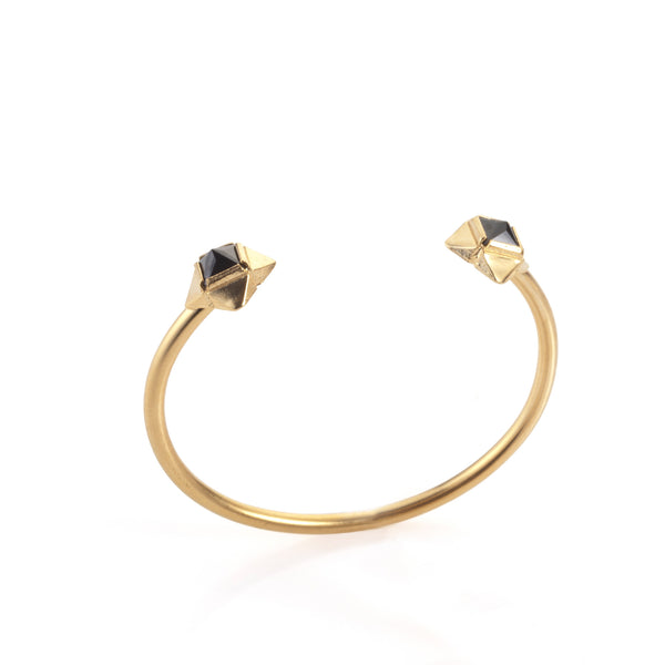 gold plated open bracelet with black stones