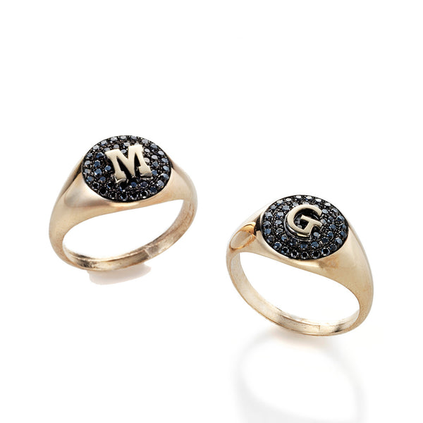 14k gold ring with a letter and black diamonds