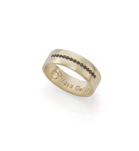 14k gold ring with a line of black diamonds