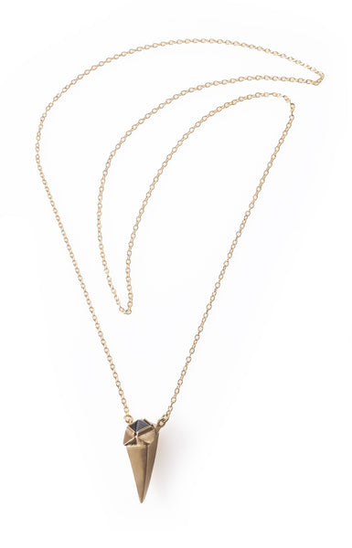 Gold plated tooth necklace with a black stone