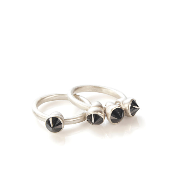 Silver ring with moving black stones