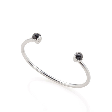 Open silver bracelet with black stones