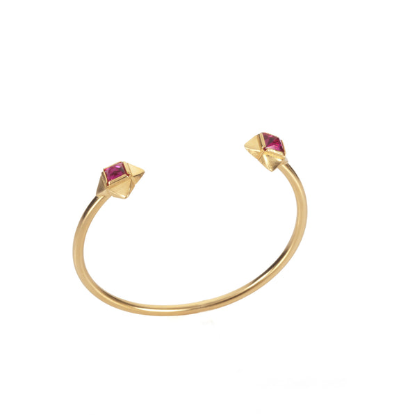 gold plated open bracelet with pink stones