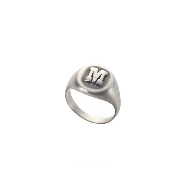 silver pinky ring with a letter