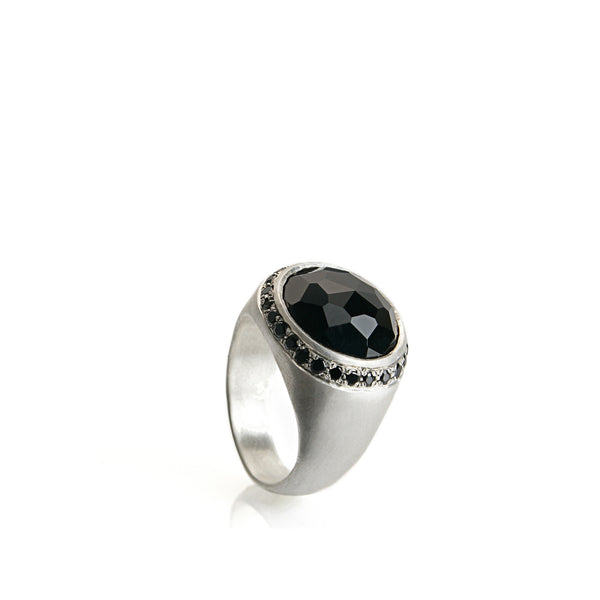 Silver signet ring with onyx and small black stones