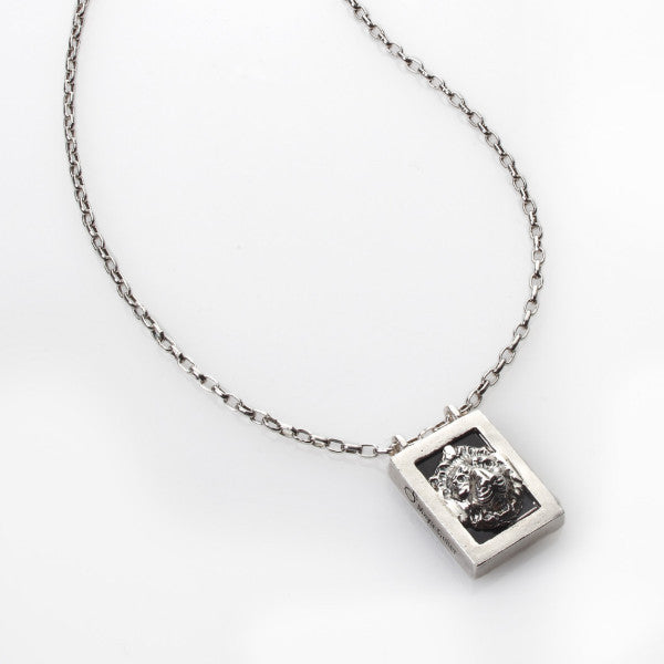 silver necklace with a lion signet