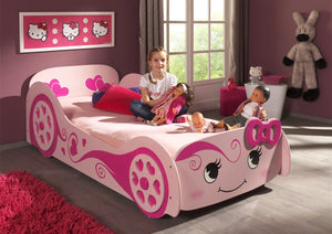 Girl sitting on Pink Princess Bed