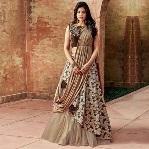 Chiku Colored Partywear Embroidered Jacquard Silk-Net Lehenga Choli