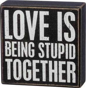 Love is Being Stupid Together Wall Sign