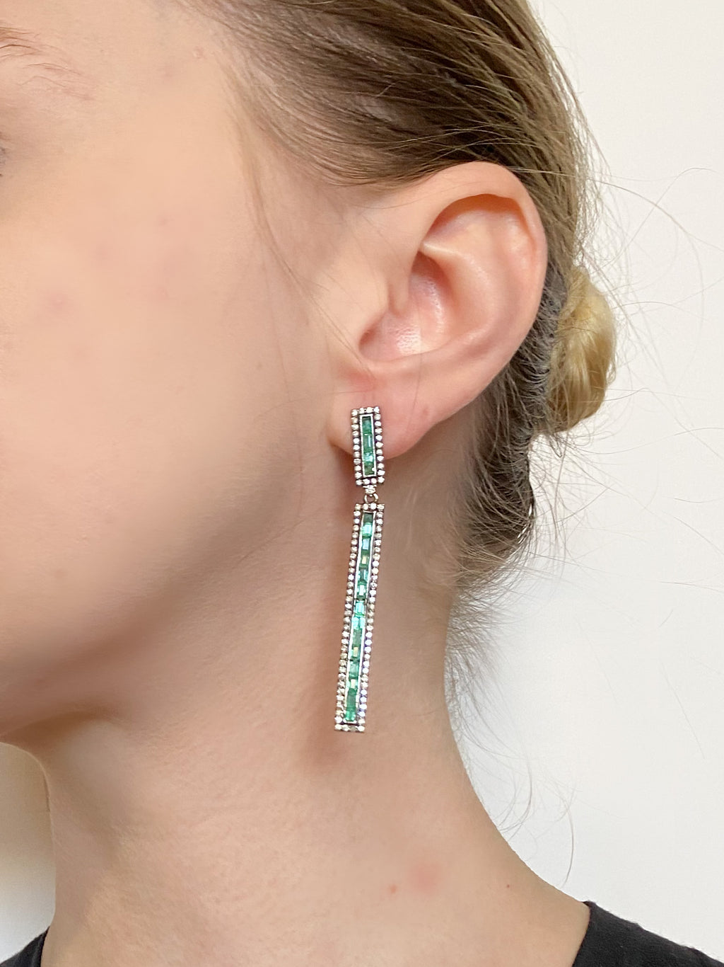 Emerald Baguettes surrounded by Round Diamonds