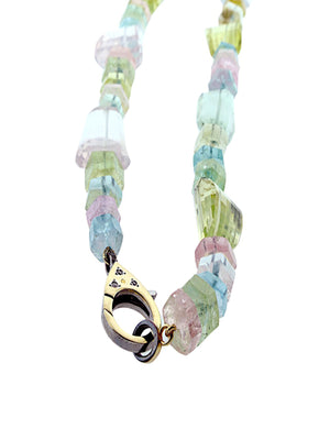 Aquamarine Multi Shaped Beads with Diamonds set in 14kt Clip.