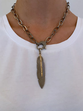 Sterling Center Baguette on Brass Etched Feather Pendant.