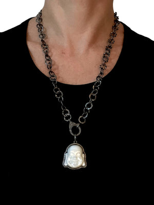 Pave Diamonds surrounding Mother of Pearl Buddha