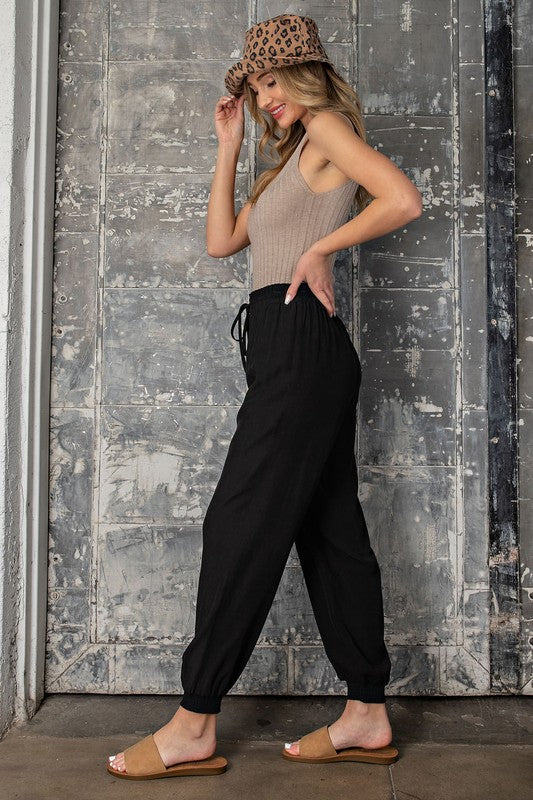 BLACK SMOCKED JOGGER PANTS