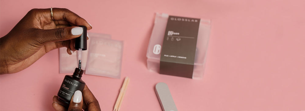 The Gel Eraser Kit being shown in action that removes soft gel polish in minutes. This in-salon formula can now be used at-home.