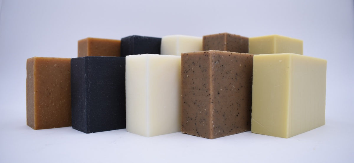 Two sets of five varieties of fragrance-free soap lined up for group photo.