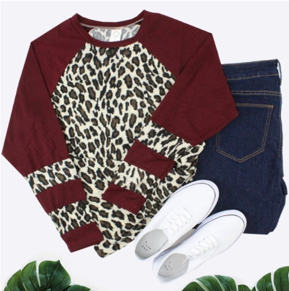 Leopard with striped sleeves