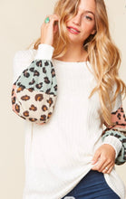 Springing for Leopard Top