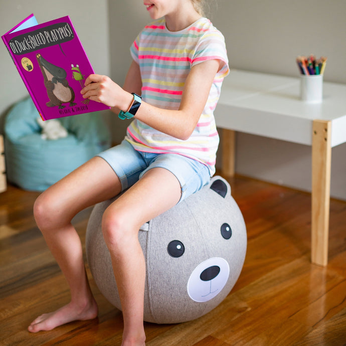 Balance ball chair exercise chair with girl sitting reading book