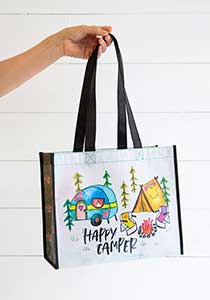 REcycled bag with colorful vintage trailer and pup tent behind campfire with happy camper script
