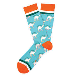 "blue novelty sock with white camels that have ""hump day"" written above them. green white and orange color blocking at the heel toes and top band of sock"