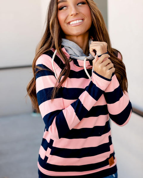 Smiling model wearing striped double hoodie from Ampersand and Ave