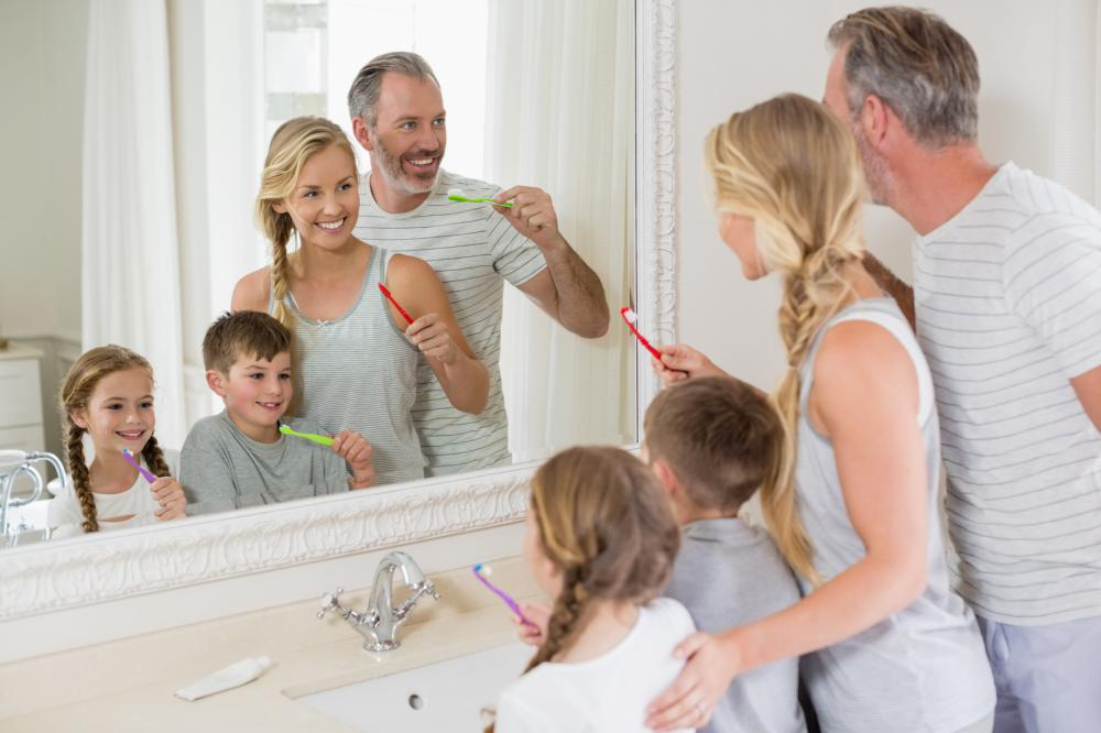 Parents and kids brushing teeth in the bathroom