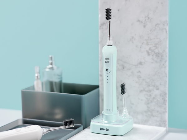 An image of the Lake Blue ION-Sei electric toothbrush on a counter.