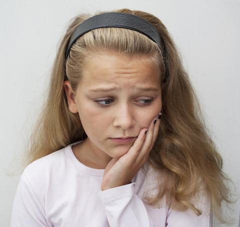 child-complains-of tooth decay
