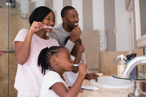 parents brushing teeth with the child