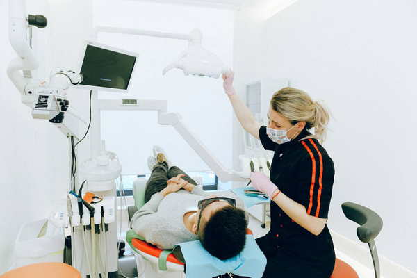 A man getting a dental check-up by a professional dentist.