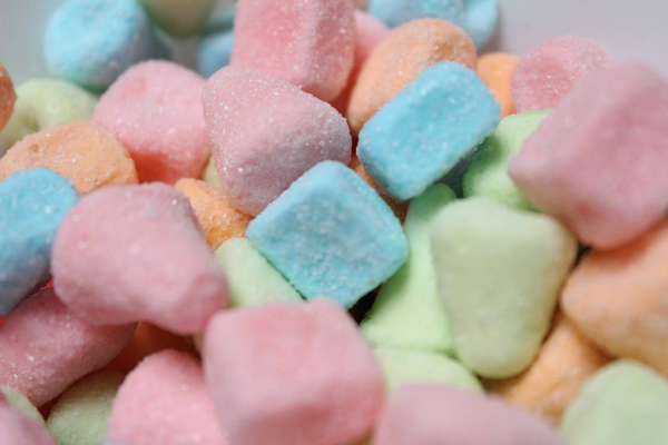 An image of colorful sour candies.