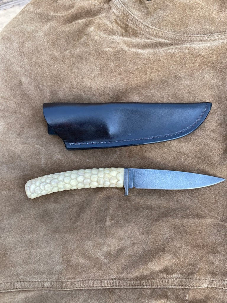 Carved Damascus hunter