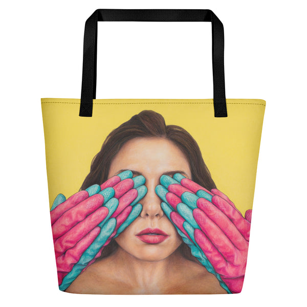 large yellow tote bag with art of pink & blue rubber gloves covering a woman's eyes