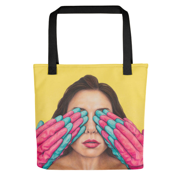 tote bag with art of pink and blue rubber gloves covering woman's eyes on yellow background
