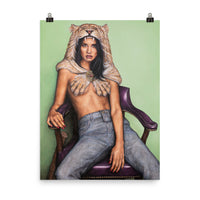 An 18 inch by 24 inch museum quality liana z weber artworks original poster. beautiful and affordable wall art of a strong female sitting, leaning back in a purple chair against a soft light green background. She is wearing a lion headdress and is staring boldly at the viewer. She is the female version of the legendary mythological character Hercules. A strong and badass woman that needs no one and is self assured.