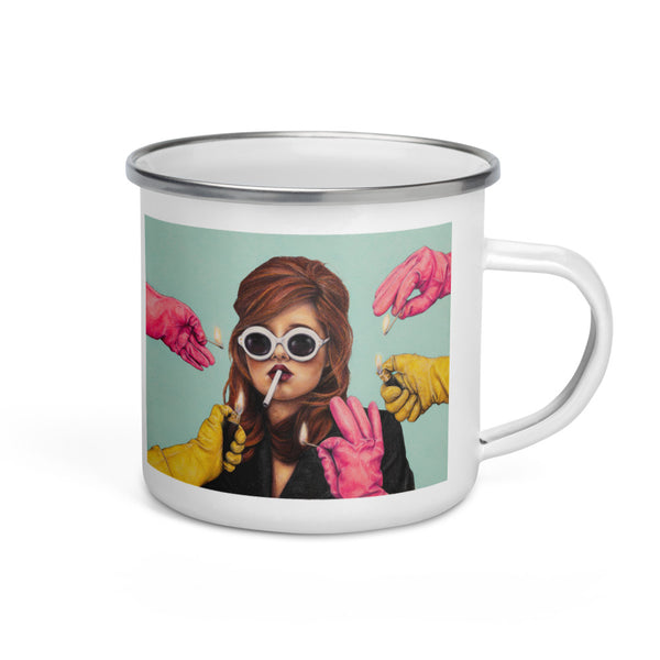 white enamel mug with art of lady smoking while pink & yellow gloves offer a light on dusty blue