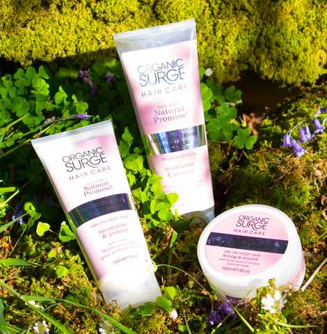 Organic Surge Moisture Boost Haircare sits in the grass