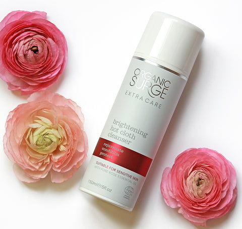 Spring Hot Cloth Cleanser next to flowers