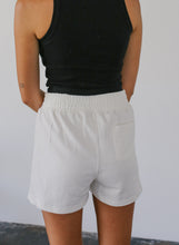 Load image into Gallery viewer, woman in white high-waisted shorts with small patch pocket