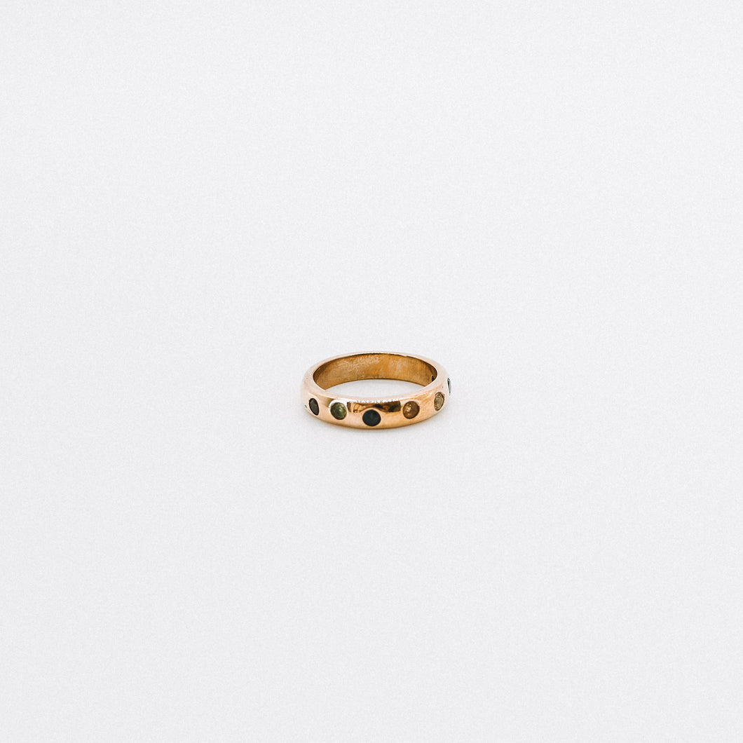 Rounded thick gold band with coloured pressed stones around
