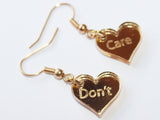 Gold DON'T CARE Dangle Earrings - Feelin Peachy