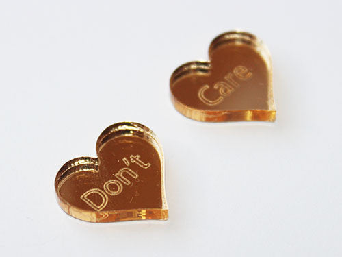 Gold DON'T CARE Stud Earrings