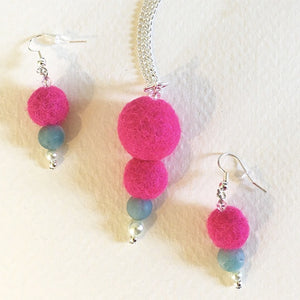 Felted necklace magenta balls & blue bead